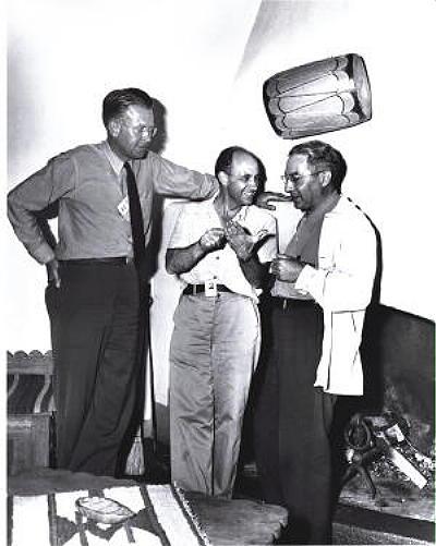 Scientists E.O. Laurence, Enrico Fermi & I.I. Rabi discuss work on the Manhattan Project.jpg